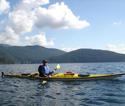 Dr. Bebbington ocean kayaking off of Deep Cove in British Columbia
