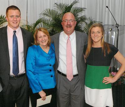 Dr. Janet Scheel with husband Dr. Paul Scheel and their children