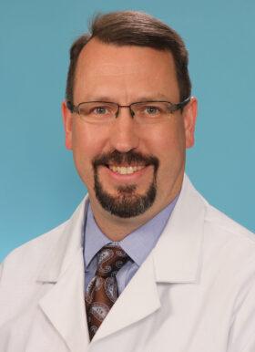 Mark E. Halstead