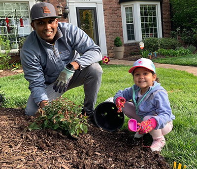Teaching his daughter how to garden